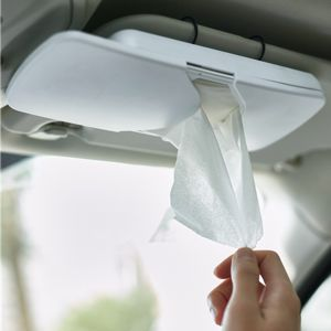 convenient tissues in clip on container that attaches to your car sun visor