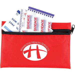small pocket size first aid kit showing custom printed logo, open with bandaids