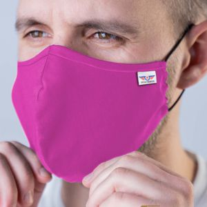 3 ply cotton face mask in pink with woven label shown worn