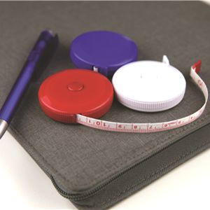 round plastic tape measure shown in red, blue and white colours